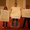 "A children's presentation was a special addition to Church Women United-Newtown and Danbury's celebration of World Community Day on November 6. Carolyn Wolf, Devin Peterson, and Elizabeth Wolf, from left, used pantomime and pictures to present ""The Story of Creation.""  (Hicks photo)"