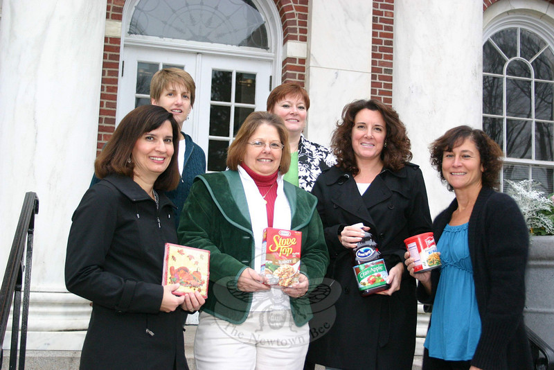 Women Involved in Newtown (WIN) members show off some of the items they have already received for this year's Thanksgiving Basket Program. From left is Colette Ercole, Wendy Delehanty, Audrey Locorotondo, Alison Gilbert, Cyndy DaSilva, and Sue Rubino. The collection will continue until November 20.  (Hicks photo)