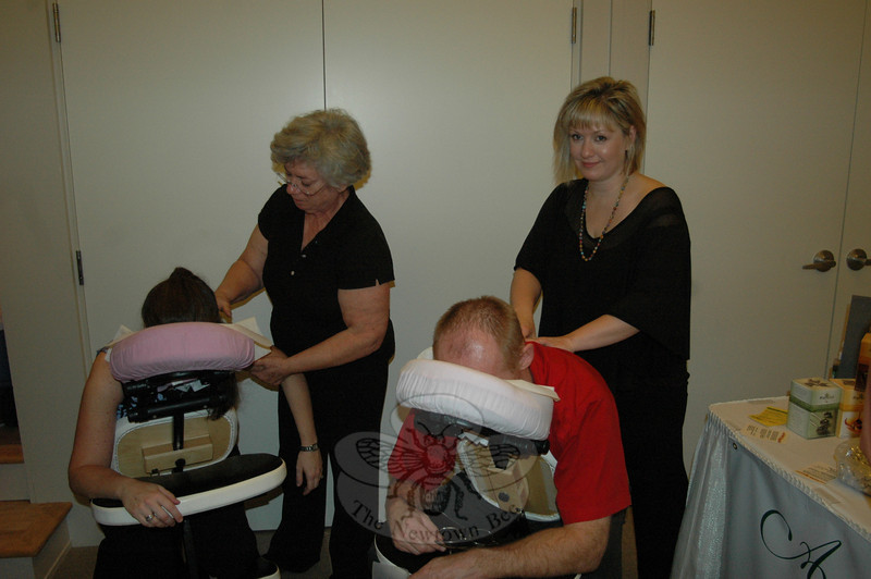 Destination Newtown visitors not only got to sample the wares of local businesses, but various services, as well. Here, Cynthia Campel, left, and Dawn Turcott of Avancé Esthétiques provide soothing massages.  (Voket photo)