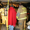 Firefighters from Hawleyville, Hook & Ladder, Sandy Hook and Dodgingtown responded to an accidental fire within a garage on the basement level of a raised-ranch home on Haw-thorne Hill Road, off Saw Mill Road, on the night of Monday, November 16. There were no injuries in the fire, which caused both char damage and smoke damage to the structure. An electrical problem caused the blaze.  (Hicks photo)