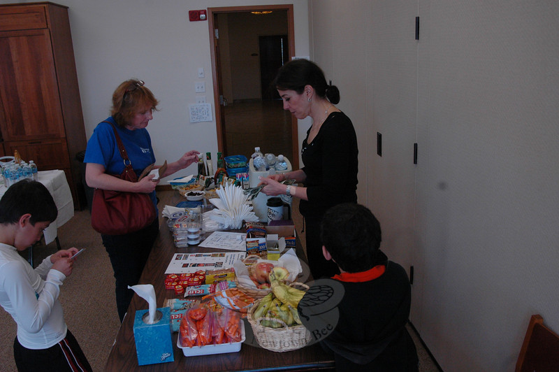 Temple member Liz Bogdanoff volunteered to handle the healthy snack table during Con-gregation Adath Israel's Health Fair on November 8.  (Voket photo)