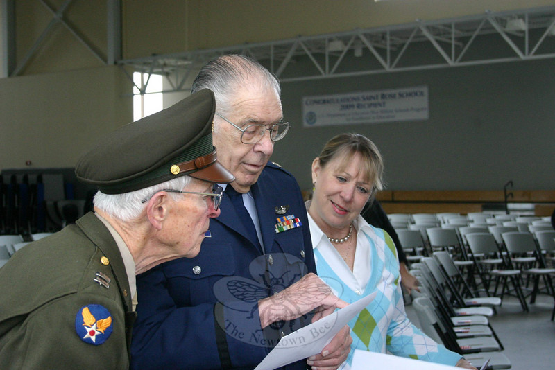 St Rose School Nurse Bonnie Nezvesky, right, shared her collection of World War II memo-rabilia with the four veterans who visited the parochial school last week. Looking on prior to their presentation to the students were Lieutenant Colonel Walter Hushak, left, and Lieu-tenant Colonel Jim Fontana.  (Hicks photo)