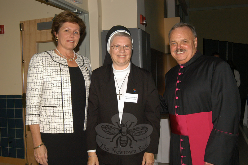 St Rose of Lima Principal Mary Maloney, left, Director of St Rose of Lima Preschool Sister Thaddeus Rajca, and Monsignor Robert Weiss stand together as Saturday's celebration of the Blue Ribbon award began.  (Hallabeck photo)