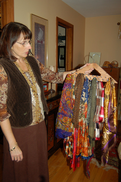 Tina Welsh uses a hanger intended for men's neck ties to store her large collection of color-ful scarves neatly.  (Crevier photo)