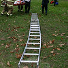 An unidentified man in his 20s was injured about 1:38 pm on November 13 at 27 Dayton Street in Sandy Hook Center when a tree branch fell on him, according to Sandy Hook Vol-unteer Fire and Rescue Company Chief Bill Halstead. The man who was injured had been on the ground stabilizing a ladder for another man on the ladder who was working to re-move that branch from a tree, the fire chief said. About 20 firefighters responded to the scene. Ambulance volunteers transported the injured man for hospital treatment, Chief Halstead said.  (Hicks photo)