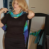 Pam Friedlander, a wardrobe consultant, demonstrates how today's popular long and light scarves can be twisted together in duplicate or triplicate and then simply tossed over the shoulders for a sharp look.  (Crevier photo)