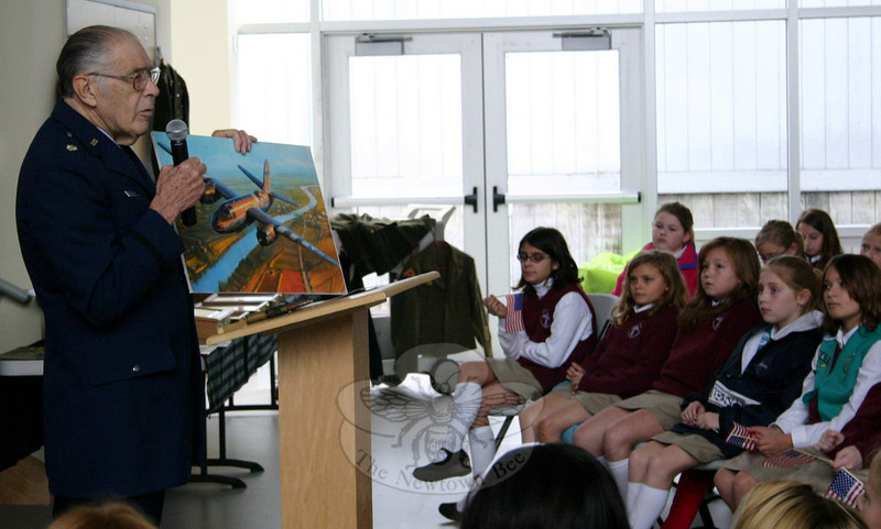 Colonel Jim Fontana used a series of photos to show St Rose School students the different planes he learned to fly in 1942, when he was drafted into the Army Air Force.  (Hicks photo)