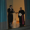 Newtown's State Representative Chris Lyddy, left, spoke at St Rose of Lima School during Saturday's private celebration for the school being awarded the 2009 Blue Ribbon School of Excellence. Monsignor Robert Weiss, right, led the evening's ceremonies.  (Hallabeck photo)