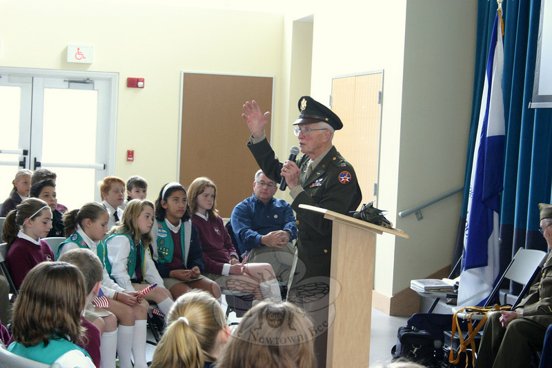 Walter Hushak, who served in the 7th USAF during World War II, was the unofficial group leader of the veterans who visited St Rose School for a belated Veterans' Day observation on November 13.  (Hicks photo)