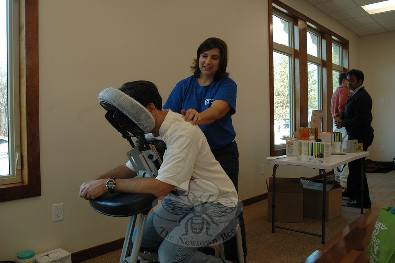 Massage therapist and Newtown resident Laura Callahan, working some of the kinks out of congregation member Bob Bogdanoff during the Congregation Adath Israel Health Fair.  (Voket photo)