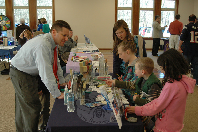Congregation Adath Israel hosted a health fair November 8 featuring a number of exhibitors and information sources to help promote community wellness. Among the exhibitors were Dr Aaron Gilman of Dental Associates, pictured chatting with Hanna Fink, 8, of Monroe (in flowered hoodie) and several other young visitors about appropriate brushing techniques.  (Voket photo)