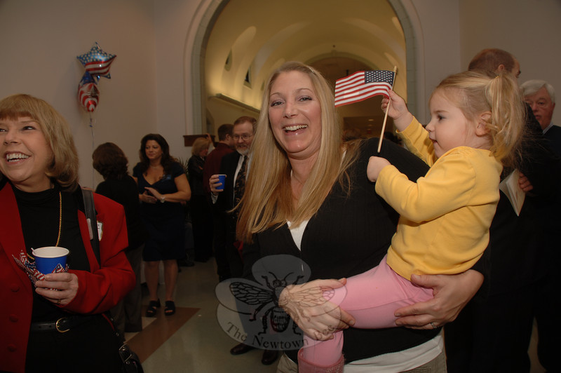 Sue Blanar and her daughter Sophia joined Monday's celebration and swearing-in ceremony for Newtown's recently elected municipal officials. Her sister and Town Clerk Debbie Aurelia stands in the background, left.  (Bobowick photo)