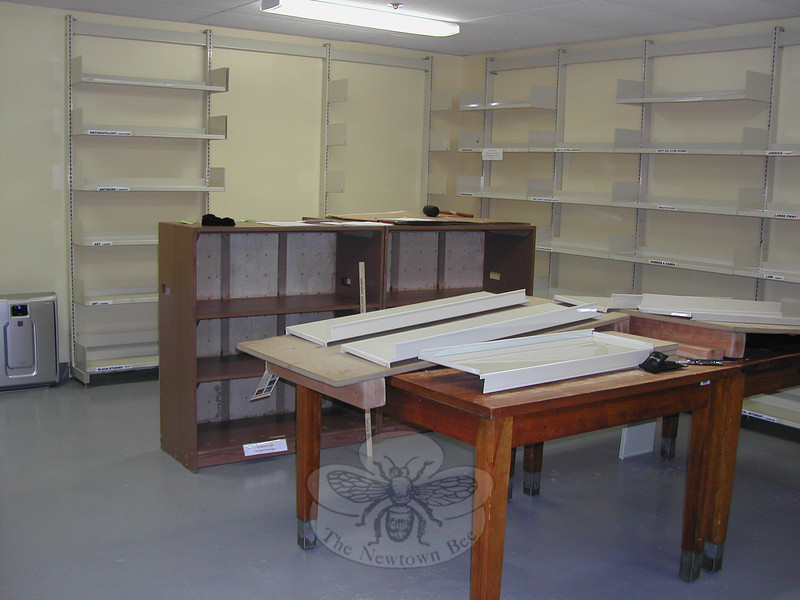 Shelving awaits replacement on the newly patched and painted walls of the C.H. Booth Li-brary book room on the lower level. The book room, staffed each week by Friends of the C.H. Booth Library volunteers, also received a durable epoxy floor during recent renovations to the space that houses the thousands of donations for the Friends' Annual Book Sale. Volunteers expected to be back in business by Monday, November 23, sorting, categorizing, cleaning, and pricing the valued donations of books, DVDs, CDs, and other items.  (Crevier photo)