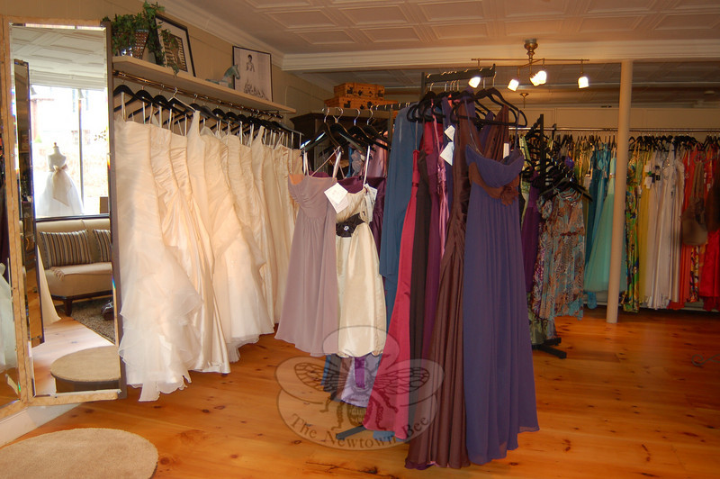 Wedding gowns, including several styles ideal for destination weddings, bridesmaids' gowns, and updated looks for the mothers of brides and grooms are found at Sabrina Style.  (Crevier photo)