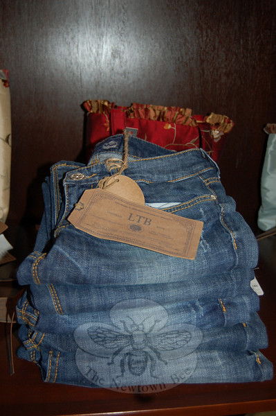 While the focus at Sabrina Style is on special occasion dresses, the store carries a number of casual wear items, including jeans by Sham and LTB.  (Crevier photo)