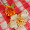 A marigold-style flower and a lily-style flower are easy to make following instructor Katie Stevenson's directions.  (Crevier photo)