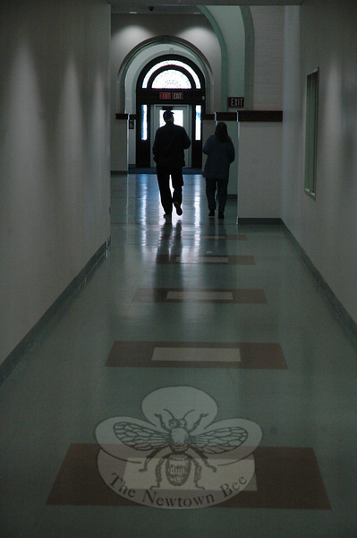 Two residents walk in the stately main hallway at the Newtown Municipal Center on Saturday, November 21, when dedication ceremonies were held for the new town office building. The public toured the facility.  (Gorosko photo)