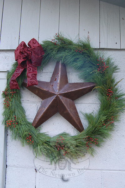 Branches of white pine are wrapped gracefully about a metal ring with a star center to create a simple but elegant wreath.  (Crevier photo)
