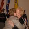First Selectman-elect Pat Llodra embraces Governor M. Jodi Rell Monday as the governor swore in Mrs Llodra and then representatives from various town boards and commissions en masse. (Bobowick photo)