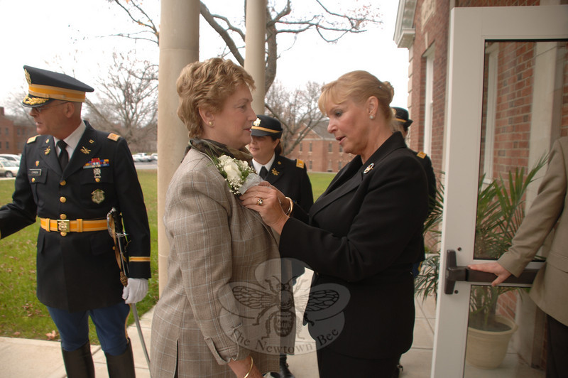 Governor Jodi M. Rell received a corsage that State Representative Debra-Lee Hovey pinned a corsage to Governor M. Jodi Rell's blouse on Monday when she arrived at Newtown Municipal Center in Fairfield Hills.  (Bobowick photo)