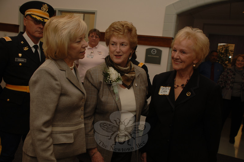 Governor M. Jodi Rell was greeted by, from left, Second Company Governor's Horse Guard Major Gordon J. Johnson, Superintendent of Schools Janet Robinson, and to the governor's right First Selectman-elect Pat Llodra, when she arrived at Newtown Municipal Center on Monday.  (Bobowick photo)