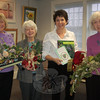 Garden Club of Newtown members, from left, Ginnie Carey, Beryl Harrison, Beth Caldwell and Connie Urso show off some of the items that will be offered on December 5 when the club presents its annual Greens Sale at Newtown Meeting House.  (Hallabeck photo)