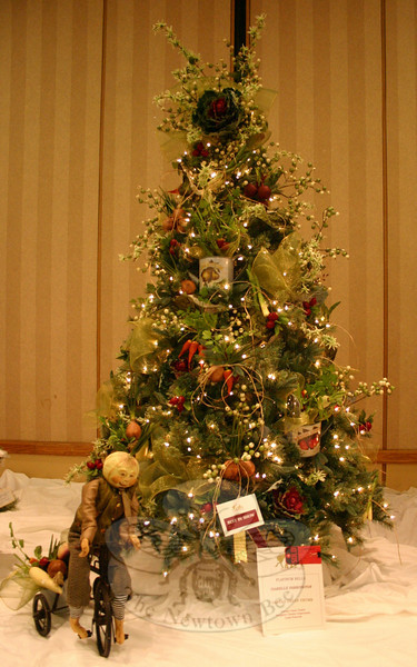 """Linda Pickwick and Claudia Coopersmith designed this tree, called """"Santa's Green Thumb,"""" for Ann's Place Festival of Trees. Sponsored by Isabelle Farrington, the tree was honored as Best in Show.  (Hicks)"""