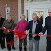 First Selectman Joe Borst, second from right, cut a ceremonial ribbon at dedication ceremonies held on Saturday, November 21, at Newtown Municipal Center. Also pictured, from left, Director of Economic and Community Development Elizabeth Stocker, State Representative DebraLee Hovey, First Selectman-elect Pat Llodra, and Selectman Herb Rosenthal.  (Gorosko photo)
