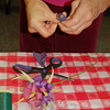 Tightly rolled strips of colored cornhusk formed the core for paper flowers at a recent flower-making workshop at C.H. Booth Library, led by artist Katie Stevenson.  (Crevier photo)