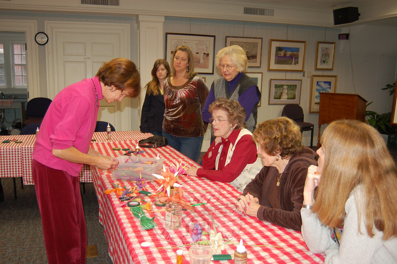 Katie Stevenson demonstrated the art of making paper flowers. From left are Celina Weigel, Wendy Eurell, Mary Peck, Marie Walker, Marianne Muskus, and Chris Beaudoin.  (Crevier photo)