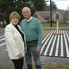 Patricia and Robert Kubit, who live at 11 Glover Avenue, shown in the background, are concerned about the negative effects of a raised crosswalk, which the town recently installed on Glover Avenue in front of their house. The town is experimenting with raised crosswalks on Glover Avenue and Queen Street to gauge the practicality of the hard rubber devices in providing a safe place for pedestrians to cross the street.—Bee Photo, Gorosko