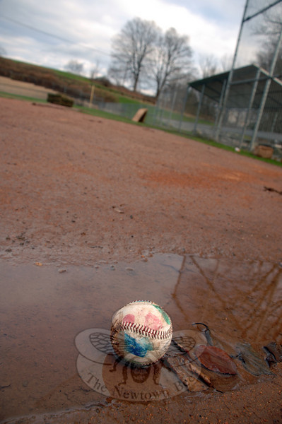 A lonely baseball is left behind on Liberty Field where the Parks and Recreation department is doing maintenance. (Bobowick photo)