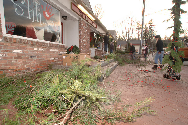 Greens filled the sidewalk in Sandy Hook as the decorating progressed.