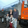 A true family business, Newtown resident Richard Paltauf (right), stands beside his new home heating delivery truck with his wife, Cindy, and their children, Nate, 8, and Emily, 5. The local company is be-ing operated out of the family's residence in Dodgingtown, and serves new and existing clients through-out northern Fairfield and New Haven Counties and southern Litchfield County.  (Voket photo)