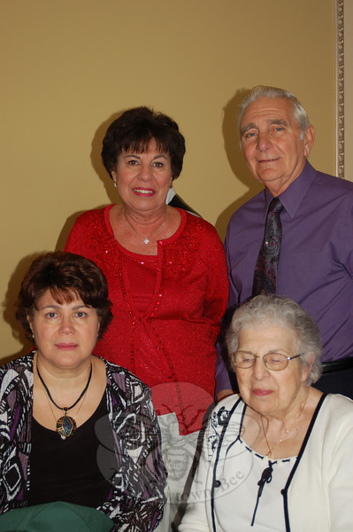 Former Newtown Parks and Recreation director Barbara Kasbarian and husband Fred (standing) joined Mrs Kasbarian's mother, Mickey Bistany, seated right, and her sister, Carol Bistany, at The Waterview for Newtown Senior Center's Holiday Party.  (Crevier photo)