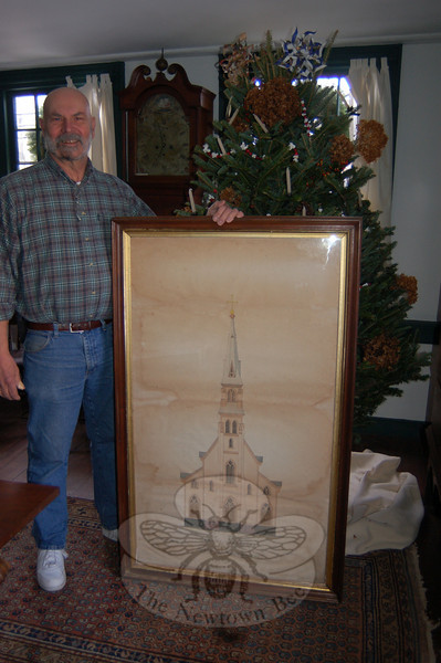 John Renjilian stands next to the four by three foot rendering of the old St Rose Church that he donated recently to Newtown Historical Society. The drawing will find a permanent home in The Matthew Curtiss House on Main Street.  (Crevier photo)