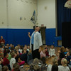 "Presenter Scott Jameson shared his show, ""Contact: The Magic of Communication,"" with Middle Gate Students on Friday, December 4. Here, Mr Jameson stands a newspaper up straight above him.  (Hallabeck photo)"
