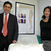 Dr Alex Afshar stands with Marie Armington, director of business development at Newtown's Vein Institute. Between them is a poster Dr Afshar uses to illustrate the effects of varicose veins and how several treatments he offers can relieve pain while cosmetically renewing his patients' physical appearances.  (Voket photo)