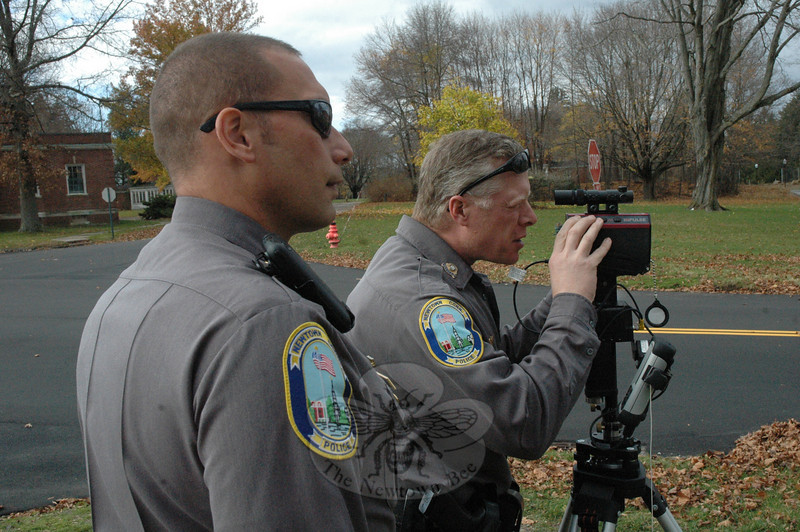 Police Officer David Kullgren, left, looks on as Officer Steve Ketchum looks through the sight of a laser-based measuring device while on a motor vehicle accident investigation training project at Fairfield Hills.  (Gorosko photo)