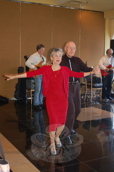 Rosemarie and Tony Rigoglioso floated gracefully upon the polished dance floor of The Waterview, while members of The Country Gentlemen played in the background during the Newtown Senior Center Annual Holiday Party.  (Crevier photo)