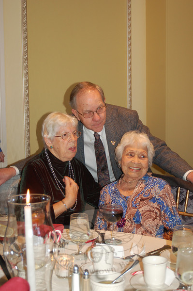 Bob Sharpe greeted friends Barbara Wadleigh, left, and Minerva Bianco at the Newtown Senior Center Annual Holiday Party.