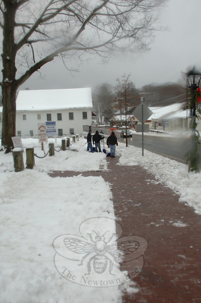 Shovelers cleaned the walks along Church Hill Road in Sandy Hook.  (Bobowick photo)