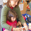 Cara Pellicone and her daughter Julia made a gingerbread house together on Friday, De-cember 18, in the Sandy Hook School classroom of teacher Kaitlin Roig, along with the rest of Julia's classmates.  (Hallabeck photo)