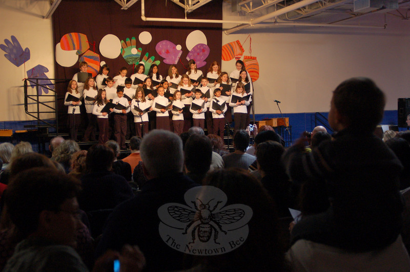 "Myriam Woods, head of Fraser-Woods School, introduced this school year's Holiday Celebration ceremony on Thursday, December 17, before the school's chorus, above, began the day's event by singing, ""Do You Hear What I Hear?""  (Hallabeck photo)"