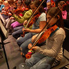 Students in Newtown Middle School's seventh grade orchestra practiced for their upcoming Winter Concert, on Thursday, December 17, in the auditorium of Newtown High School. (Hallabeck photo)