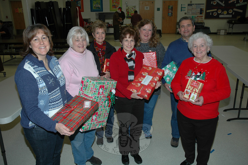 The Newtown Fund organized the delivery of Christmas gifts to 72 needy local families on Saturday, December 19. Among the volunteers who participated at Depot Day, from left, Anne Ragusa; Sharon Maynard, Newtown Fund treasurer; Joanne Klopfenstein, from Newtown's Social Services department; Doreen Kostecki, Newtown Fund president; Linda Bates, Newtown Fund vice president; Rick Mazzariello, and Terry Curry.  (Gorosko photo)