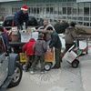 Adults and youths joined forces on a frigid Saturday, December 19, loading vehicles which had come to Sandy Hook School to transport bundles of donated Christmas gifts to local needy families, all part of The Newtown Fund's Depot Day.  (Gorosko photo)