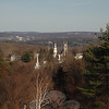 Looking down on the town from a peek on Castle Hill is the town's notorious panorama of the flagpole, church steeples, and rooster perched atop Newtown Meeting House, all pushing through a canopy of trees covering that hillside.  (Bobowick photo)