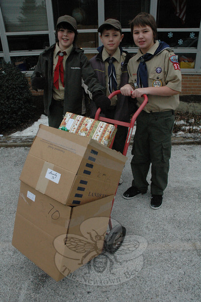 Three Boy Scouts from Troop 370 paused for a moment during The Newtown Fund's Depot Day activities at Sandy Hook School on December 19. From left is Jacob Branchflower, James Craig, and Stephen Pansa.  (Gorosko photo)