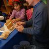 Ken Walters, right, helped Sandy Hook School student Chris Berke make her gingerbread house on Friday, December 18.  (Hallabeck photo)
